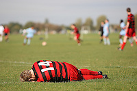 A Hoxton Foxes FC player lies injured on Hackney Marshes as the Hackney & Leyton Sunday League match with Wenlock Arms continues in the background - 19/10/08 - MANDATORY CREDIT: Gavin Ellis/TGSPHOTO - Self billing applies where appropriate - Tel: 0845 094 6026