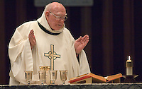 A priest says Mass  at the Belmont Abbey Basilica in Belmont, NC.