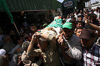 """Palestinians carry the body of Hamas security officer Omar Al-Seer during his funeral in the southern Gaza Strip May 10, 2008. Two Israeli air strikes killed five Hamas security men in the Gaza Strip, Palestinian medical officials and Hamas said. An Israeli army spokeswoman said the air strikes were in response to continued cross-border attacks""""photo by Fady Adwan"""""""