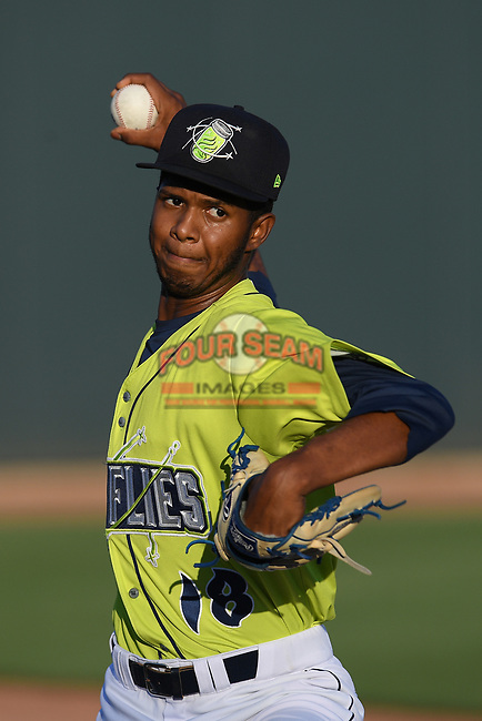 Starting pitcher Daison Acosta (18) of the Columbia Fireflies warms up before a game against the Hickory Crawdads on Wednesday, August 28, 2019, at Segra Park in Columbia, South Carolina. Hickory won, 7-0. (Tom Priddy/Four Seam Images)
