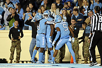CHAPEL HILL, NC - NOVEMBER 02: Dyami Brown #2 of the University of North Carolina celebrates his third touchdown with Michael Carter #8 and Dazz Newsome #5 during a game between University of Virginia and University of North Carolina at Kenan Memorial Stadium on November 02, 2019 in Chapel Hill, North Carolina.