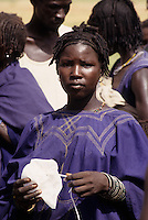 Near Bankilare, southwestern Niger - Bella Woman Holding Plastic for Guinea Worm Water Filter