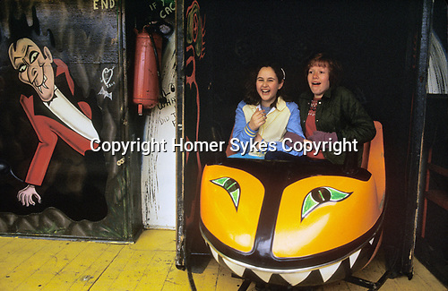 Annual Kings Lynn funfair Norfolk England 1980s opening on St Valentines Day. House of Horrors traditional hand painted design 1982 UK