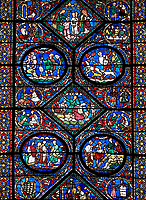 Medieval stained glass Window of the Gothic Cathedral of Chartres, France - dedicated to the life of Eustace . Central panel shows act 2 ?the Tragedy and Exile? , central diamond -   The sailors kidnap Eustace's wife, casting him overboard , below left - possibly Eustace negotiating passage to Egypt, below right Eustace and his family board a boat to Egypt . Above left - Before Eustace can reach land, a lion snatches away his eldest son, above right -  Shepherds rescue Eustace's younger son from the jaws of a wolf. A UNESCO World Heritage Site.