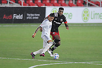 WASHINGTON, DC - AUGUST 25: Gustavo Bou #7 of New England Revolution battles for the ball with Donovan Pines #23 of D.C. United during a game between New England Revolution and D.C. United at Audi Field on August 25, 2020 in Washington, DC.