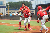 GCL Phillies East Jose Cedeno (back) and Jose Tortolero (with bat) celebrate after a walk off sacrifice fly during a Gulf Coast League game against the GCL Yankees East on July 31, 2019 at Yankees Minor League Complex in Tampa, Florida.  GCL Phillies East defeated the GCL Yankees East 4-3 in the second game of a doubleheader.  (Mike Janes/Four Seam Images)