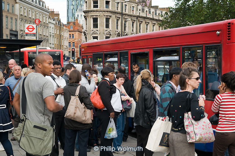 Rush hour commuters queue for buses in Kings Cross London during a one day strike by RMT union members over proposed job cuts.