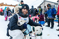 rus down Front Street on the way to the finish line in Nome  during the 2017 Iditarod on Friday March 17, 2017.<br /> <br /> Photo by Jeff Schultz/SchultzPhoto.com  (C) 2017  ALL RIGHTS RESERVED
