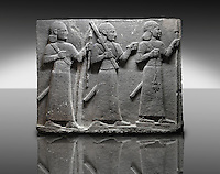 Picture & image of a Neo-Hittite orthostat of 3 warriors from the legend of Gilgamesh from Karkamis,, Turkey. The warrior on the far left holds a spear in one hand and the branch of a tree in the other. The middle warrior has a clenched fist an carries an impliment over his shoulder. The warrior on the far right carries a saff. All 3 are wearing swords.  An Ankara Museum of Anatolian Civilizations exhibit.