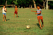 Amazonas State, Brazil. Small children playing football in a village on the Rio Negro (Amazon).