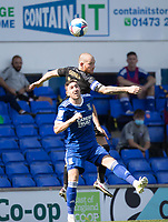 Joe Garner, Wigan Athletic,  beats Stephen Ward of Ipswich Town in the air during Ipswich Town vs Wigan Athletic, Sky Bet EFL League 1 Football at Portman Road on 13th September 2020
