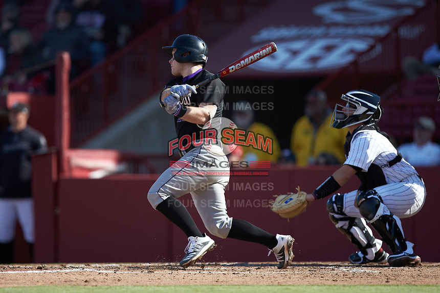 Riley Livingston (23) of the Holy Cross Crusaders follows through on his swing against the South Carolina Gamecocks at Founders Park on February 15, 2020 in Columbia, South Carolina. The Gamecocks defeated the Crusaders 9-4.  (Brian Westerholt/Four Seam Images)