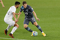 ST PAUL, MN - NOVEMBER 4: Robin Lod #17 of Minnesota United FC and Mauricio Pineda #22 of Chicago Fire FC go for the ball during a game between Chicago Fire and Minnesota United FC at Allianz Field on November 4, 2020 in St Paul, Minnesota.