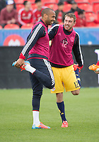 Toronto, Ontario - May 17, 2014: New York Red Bulls forward Thierry Henry #14 and New York Red Bulls midfielder Eric Alexander #12 warm-up before a game between the New York Red Bulls and Toronto FC at BMO Field. Toronto FC won 2-0.