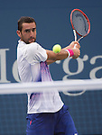 Marin Cilic (CRO) takes the first two sets against Jo-Wilfried Tsonga (FRA) 6-4, 6-4 at the US Open in Flushing, NY on September 8, 2015.