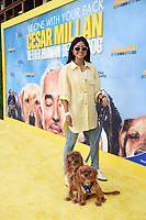 """LOS ANGELES - JULY 30: Sheryl Luke with Freddie and Bruce attend the premiere event for National Geographic's """"Cesar Millan: Better Human, Better Dog"""" at the Westfield Century City Mall Atrium on July 30, 2021 in Los Angeles, California. (Photo by Stewart Cook/National Geographic/PictureGroup)"""
