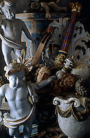 A collection of carved putti and other architectural ornaments in a storage room