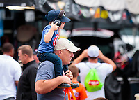 Oct 14, 2019; Concord, NC, USA; A young NHRA fan on his dads shoulders in the pits during the Carolina Nationals at zMax Dragway. Mandatory Credit: Mark J. Rebilas-USA TODAY Sports