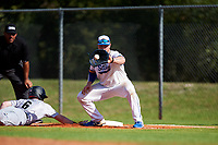 South Dakota State Jackrabbits first baseman Josh Falk (19) takes a pickoff attempt throw as Cam Walsh (6) dives back to the bag during a game against the Northeastern Huskies on February 23, 2019 at North Charlotte Regional Park in Port Charlotte, Florida.  Northeastern defeated South Dakota State 12-9.  (Mike Janes/Four Seam Images)