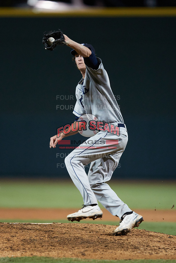 Asheville Tourists relief pitcher Danny Cody (19) fields a ground ball during the game against the Winston-Salem Dash at Truist Stadium on September 17, 2021 in Winston-Salem, North Carolina. (Brian Westerholt/Four Seam Images)