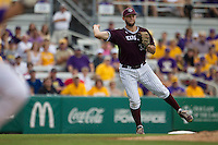 Texas A&M Aggies third baseman Ronnie Gideon (33) makes a running throw to first base during the Southeastern Conference baseball game against the LSU Tigers on April 25, 2015 at Alex Box Stadium in Baton Rouge, Louisiana. Texas A&M defeated LSU 6-2. (Andrew Woolley/Four Seam Images)