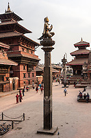 Nepal, Patan.  Durbar Square, March 2009.  Garuda Statue in foreground survived the April 2015 earthquake.  The three-tiered Hari Shankar Temple in right background was completely destroyed.  The column supporting the statue of King Yoganarendra Malla was toppled.  The royal palace and Taleju Temple on the left survived.