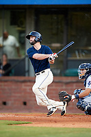 Mobile BayBears third baseman Andrew Daniel (13) follows through on a swing during a game against the Pensacola Blue Wahoos on April 25, 2017 at Hank Aaron Stadium in Mobile, Alabama.  Mobile defeated Pensacola 3-0.  (Mike Janes/Four Seam Images)