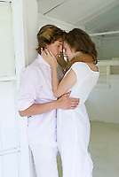 Young couple embracing in doorway