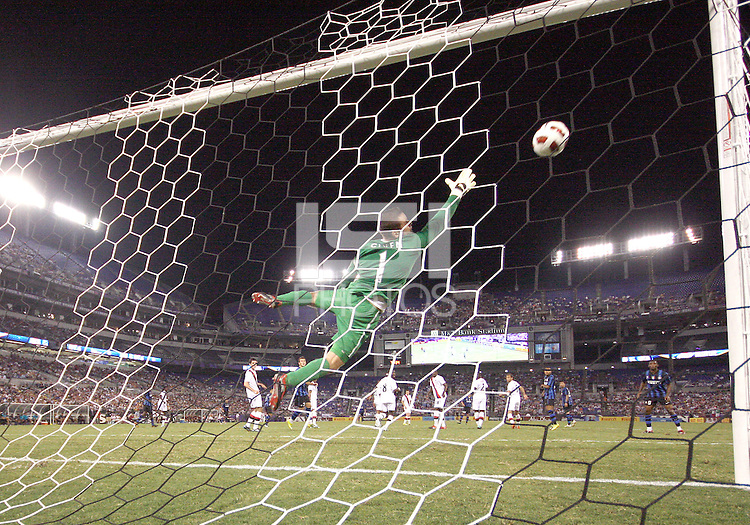Cristiano Biraghi #34 of Inter Milan beats Shay Given #1 of Manchester City for a long range goal during an international friendly match on July 31 2010 at M&T Bank Stadium in Baltimore, Maryland. Milan won 3-0.