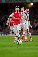 LONDON, ENGLAND - MAY 11 Héctor Bellerín of Arsenal takes the ball past Jonjo Shelvey of Swansea City  during  to the Premier League match between Arsenal and Swansea City at Emirates Stadium on May 11, 2015 in London, England.  (Photo by Athena Pictures/Getty Images)