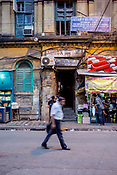 A man walks along old buildings outside the Calcutta High Court in the BBD Bagh area of Kolkata, India, on Thursday, May 25, 2017. Photographer: Sanjit Das