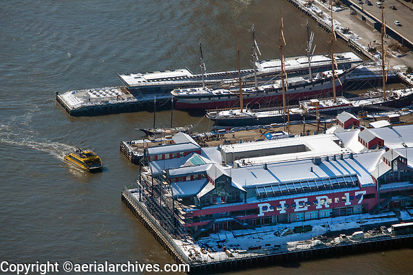 aerial photograph of a ferry approaching Pier 17 on the East River, Manhattan, New York City