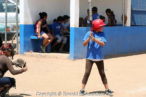 YOUNG MEXICAN GIRL AT BAT