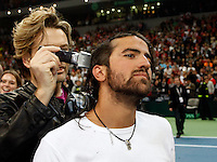 Janko Tipsarevic, center, of Serbia, gets a celebratory haircut on the court, right after the Serbian national tennis team won the Davis Cup finals against France in Belgrade, Serbia, Sunday, Dec. 5, 2010..(Srdjan Stevanovic/Starsportphoto ©)