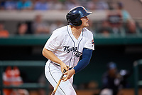 Lakeland Flying Tigers left fielder Cam Gibson (12) follows through on a swing during a game against the Tampa Tarpons on April 5, 2018 at Publix Field at Joker Marchant Stadium in Lakeland, Florida.  Tampa defeated Lakeland 4-2.  (Mike Janes/Four Seam Images)