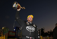Feb. 17, 2013; Pomona, CA, USA; NHRA top fuel dragster driver Shawn Langdon celebrates after winning the Winternationals at Auto Club Raceway at Pomona. Mandatory Credit: Mark J. Rebilas-