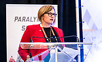 Andrea Carey introduces Narmin Ismail-Teja during the CPC Paralympic Summit 2018 at the Palliser Hotel in Calgary, Alberta on November 15, 2018.