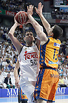 Real Madrid's Salah Mejri (l) and Valencia BC's Vladimir Lucic during Liga Endesa ACB 1st Semifinal match. June 4,2015. (ALTERPHOTOS/Acero)