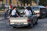 Antigua, Guatemala.  Traffic safety.  Passengers Riding in Back of Pick-up Truck, No Seat-belts.