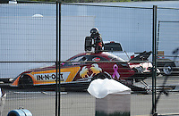 Nov. 13, 2011; Pomona, CA, USA; NHRA funny car driver Melanie Troxel climbs from her car after crashing following after a stuck throttle in the second round during the Auto Club Finals at Auto Club Raceway at Pomona. Troxel would be ok in the incident. Mandatory Credit: Mark J. Rebilas-.
