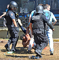 Police arrest a rioter during severe clashes   near the Congress building while Deputies Chamber was   discussing changes in   retirement legislation