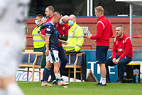25th September 2021; Dens Park, Dundee, Scotland: Scottish Premiership football, Dundee versus Rangers; Physio Gerry Docherty with Leigh Griffiths of Dundee after the striker had gone off injured