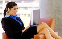 Beautiful woman working on laptop computer