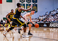 16 March 2019: University of Vermont Catamount Guard Ernie Duncan, a Redshirt Senior from Evansville, IN, drives to the top of the key in second half action against the UMBC Retrievers in the America East Championship Game at Patrick Gymnasium in Burlington, Vermont. The Catamounts defeated the Retrievers 66-49, avenging their loss against the same team in last years' Championship Game. Mandatory Credit: Ed Wolfstein Photo *** RAW (NEF) Image File Available ***