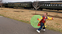 A young boy tries to control his umbrella as it's turned inside out by the wind at the North Carolina Transportation Museum in Spencer, NC.