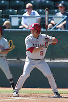 Casey Rodrigue #9 of the Indiana Hoosiers bats against the Long Beach State Dirtbags at Blair Field on March 15, 2014 in Long Beach, California. Indiana defeated Long Beach State 2-1. (Larry Goren/Four Seam Images)