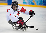 Sochi, RUSSIA - Mar 11 2014 -  Brad Bowden takes a shot as Canada takes on Czech Republic in Sledge Hockey at the 2014 Paralympic Winter Games in Sochi, Russia.  (Photo: Matthew Murnaghan/Canadian Paralympic Committee)