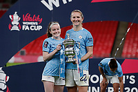 1st November 2020; Wembley Stadium, London, England; Womens FA Cup Final Football, Everton Womens versus Manchester City Womens; Rose Lavelle and Sam Mewis of Manchester City Women pose with the Womens FA Cup Final Trophy
