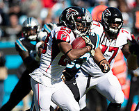 CHARLOTTE, NC - NOVEMBER 17: Brian Hill #23 of the Atlanta Falcons runs with the ball during a game between Atlanta Falcons and Carolina Panthers at Bank of America Stadium on November 17, 2019 in Charlotte, North Carolina.