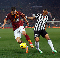 Calcio, quarti di finale di Coppa Italia: Roma vs Juventus. Roma, stadio Olimpico, 21 gennaio 2014.<br /> AS Roma midfielder Kevin Strootman, of the Netherlands, left, is challenged by Juventus midfielder Arturo Vidal, of Chile, during the Italian Cup round of eight final football match between AS Roma and Juventus, at Rome's Olympic stadium, 21 January 2014.<br /> UPDATE IMAGES PRESS/Riccardo De Luca